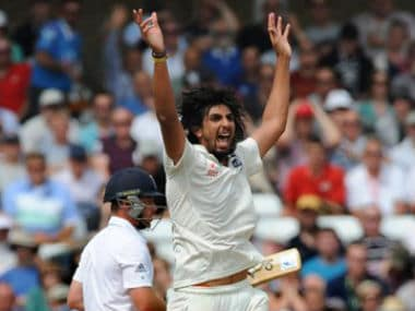 Ishant Sharma celebrates after bowling England's Ian Bell caught M S Dhoni for 25 runs during day three of the first Test between England and India. AP