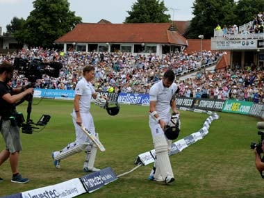 Joe Root and James Anderson walk off for lunch after breaking the record for highest 10th wicket partnership in Test cricket. AP