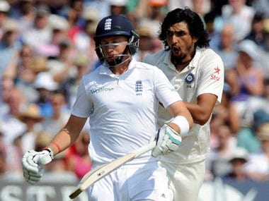 India's Ishant Sharma reacts while England's Joe Root, left, runs during day four of the first test between England and India at Trent Bridge cricket ground in Nottingham, England, Saturday, July 12, 2014. PTI.