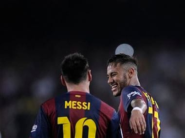 FC Barcelona's Lionel Messi is congratulated after scoring by his teammate Neymar. AP