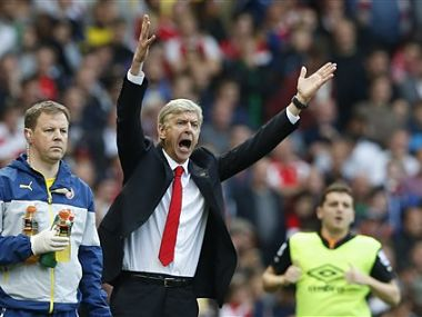Arsenal's manager Arsene Wenger, center, puts up his hands in frustration during an injury break in the English Premier League soccer match between Arsenal and Hull City. AP