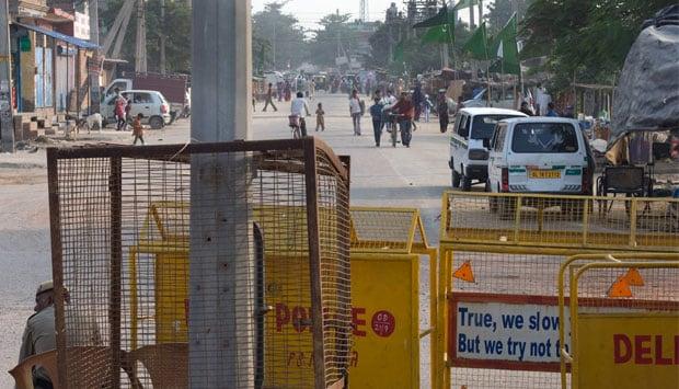 Cops guarding tense JJ Colony in northwest Delhi's Bawana locality. Naresh Sharma/ Firstpost