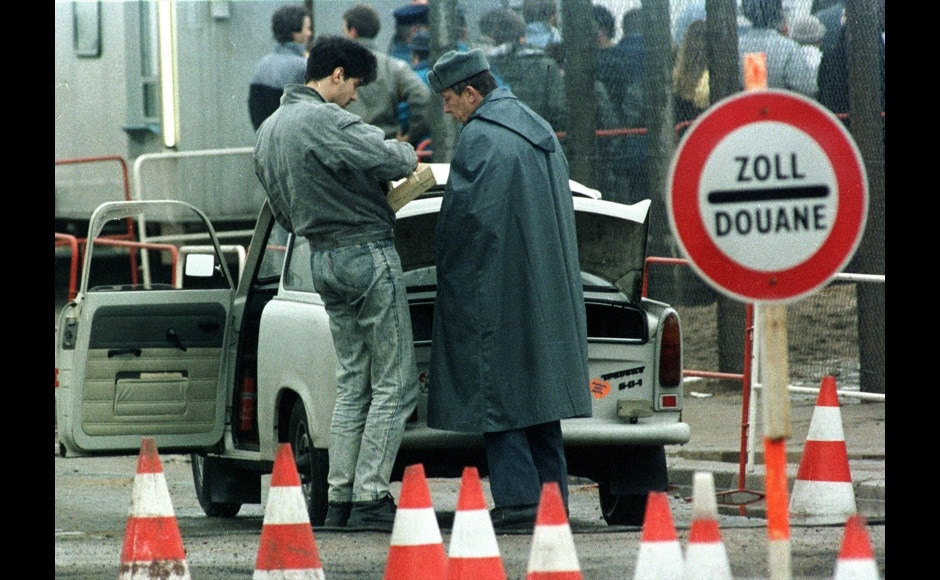 FILE PHOTO OF EAST GERMAN SEARCH ON TENTH ANNIVERSARY OF BERLIN WALL FALL.