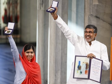 Malala and Kailash Satyarthi after receiving their Nobels. AP