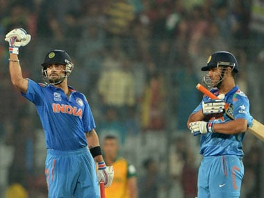 Kohli and Dhoni. AFP