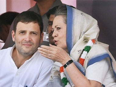 Congress president Sonia Gandhi talks to party vice president Rahul Gandhi on stage during the farmers rally at Ramlila Maidan in New Delhi on  Sunday. PTI