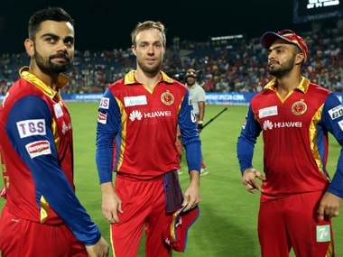 Virat Kohli (left) along with AB de Villiers (centre) and Mandeep Singh. Photo: SportzPics
