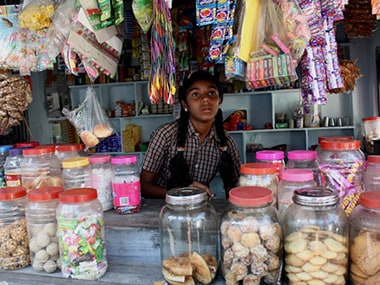 A school girl runs a small store after school hours. Image: Young Lives India Study