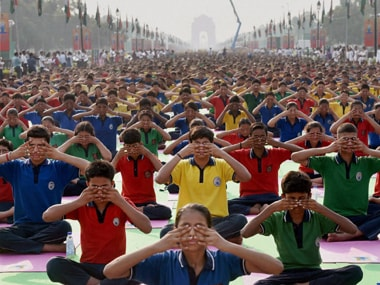 Yoga enthusiasts perform at Rajpath, New Delhi on International Yoga Day. PTI