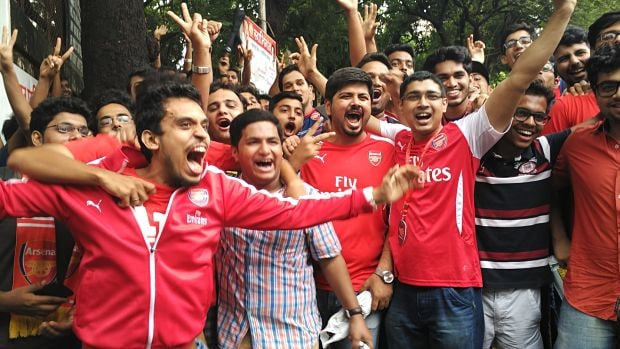 Arsenal fans in full flow outside the Mehboob studios in Bandra, before the Arsenal kit launch. Puma