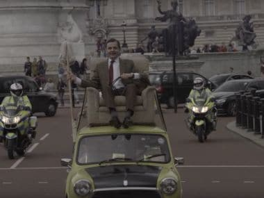 Mr Bean rides again: Rowan Atkinson celebrates 25th anniversary of show at Buckingham Palace