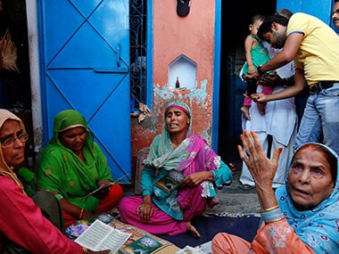 The victims' family in Dadri. AP