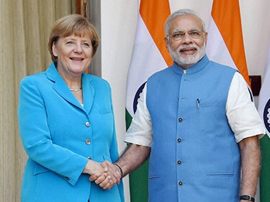 German Chancellor Angela Merkel with Prime Minister Narendra Modi. PTI