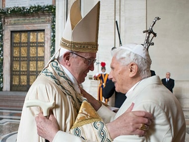 """Pope Francis (L) welcomes Pope emeritus Benedict XVI before the opening of the """"Holy Door"""". File photo AFP / Osservatore Romano"""