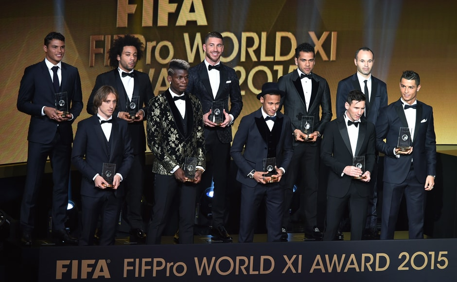 The 2015 FIFA FIFPro World XI: Brazil and Paris Saint-Germain defender Thiago Silva, Croatia and Real Madrid midfielder Luka Modric, Brazil and Real Madrid defender Marcelo, France and Juventus midfielder Paul Pogba, Spain and Real Madrid defender Sergio Ramos, Brazil and FC Barcelona forward Neymar, Brazil and FC Barcelona defender Dani Alves, Argentina and FC Barcelona forward Lionel Messi, Spain and FC Barcelona midfielder Andres Iniesta and Portugal and Real Madrid forward Cristiano Ronaldo pose on stage during the 2015 FIFA Ballon d'Or award ceremony. AFP