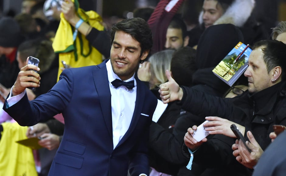 Brazil's Kaka takes a selfie photograph with fans on the red carpet as he arrives for the 2015 FIFA Ballon d'Or award ceremony. AFP
