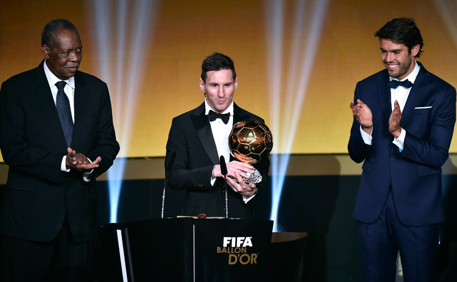 Lionel Messi delivers a speech flanked by FIFA interim president Issa Hayatou and Kaka after receiving the 2015 FIFA Ballon d'Or. AFP