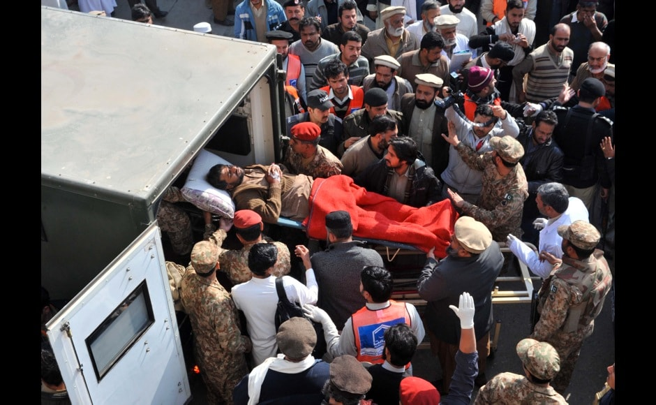 Pakistani rescuers shift an injured victim in an army ambulance from a hospital. Military spokesman Major General Asim Bajwa said on Twitter that four attackers had been killed. AFP PHOTO