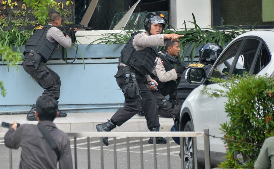 Indonesian police take position and aim their weapons as they pursue suspects outside a cafe after a series of blasts hit the Indonesian capital. Indonesia has been a victim of several bombing attacks in the past, claimed by Islamic militant groups. AFP