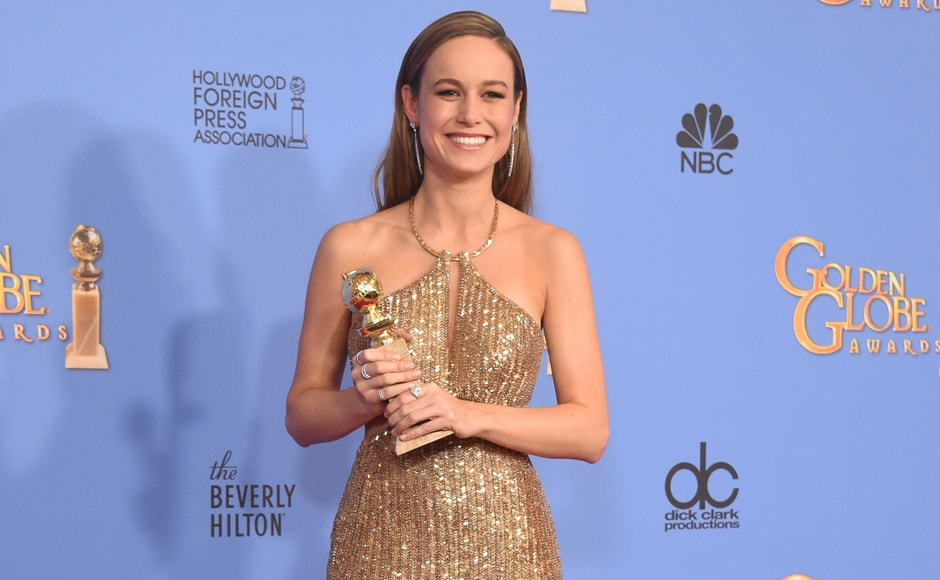 "Actress Brie Larson poses for the cameras with the award for Best Actress in A Motion Picture – Drama for her role in ""Room."" AFP"