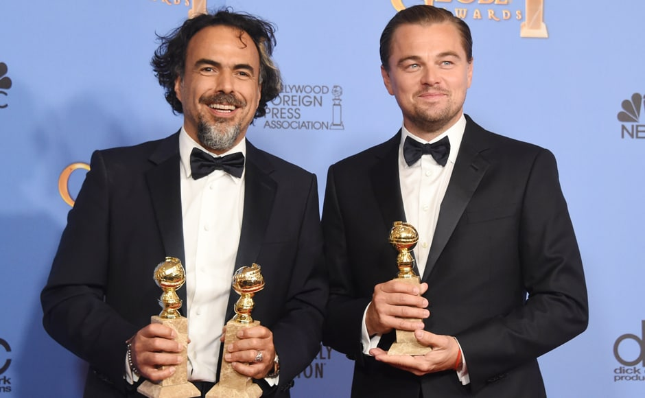 Director Alejandro González Iñárritu (L) and actor Leonardo DiCaprio pose with their awards for Best Director and Best Actor for the film 'The Revenant.' The film was also judges the best motion picture. AFP