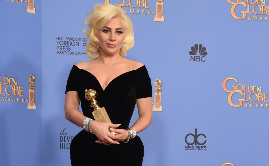 "Lady Gaga poses for the shutterbugs with the award for Best Actress TV Series or Limited Movie, for her role in ""American Horror Story: Hotel."" The award ceremony was held at Beverly Hilton Hotel in Beverly Hills, California. AFP"