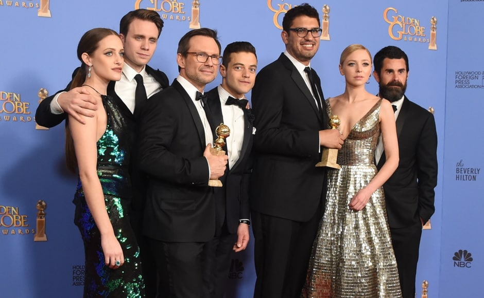 "Actors Christian Slater (3L),  Rami Malek (C) and other members of the cast and crew of ""Mr Robot"" pose with the award for Best TV Series Drama at the 73nd annual Golden Globe Awards. AFP"
