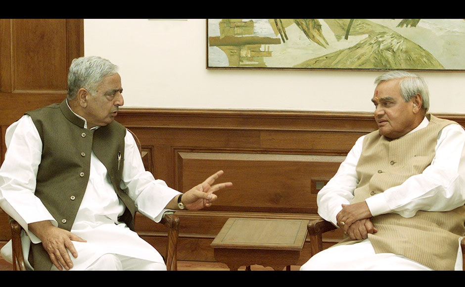Indian Prime Minister Atal Behari Vajpayee (R) listens to Mufti Mohammed Sayeed, chief minister of the troubled northern state of Jammu and Kashmir in New Delhi, April 2, 2003. Sayeed said after the meeting his government was committed to bringing peace in the state. As a chief minister from 2002 to 2005, he proved to be extraordinarily gifted at administration and political management.  Reuters