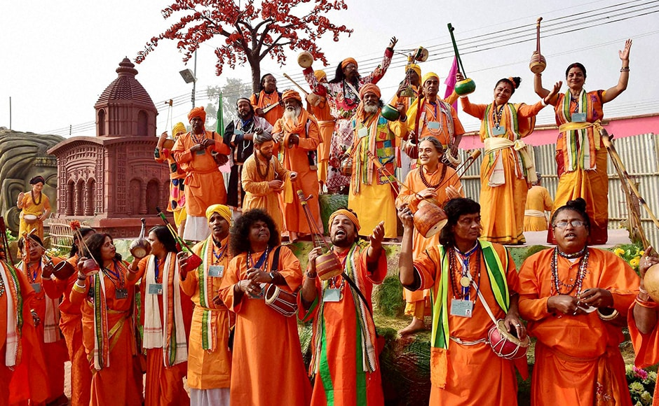 West Bengal artists pose in front of their tableau for the Republic Day parade during a press preview in New Delhi on Friday. PTI