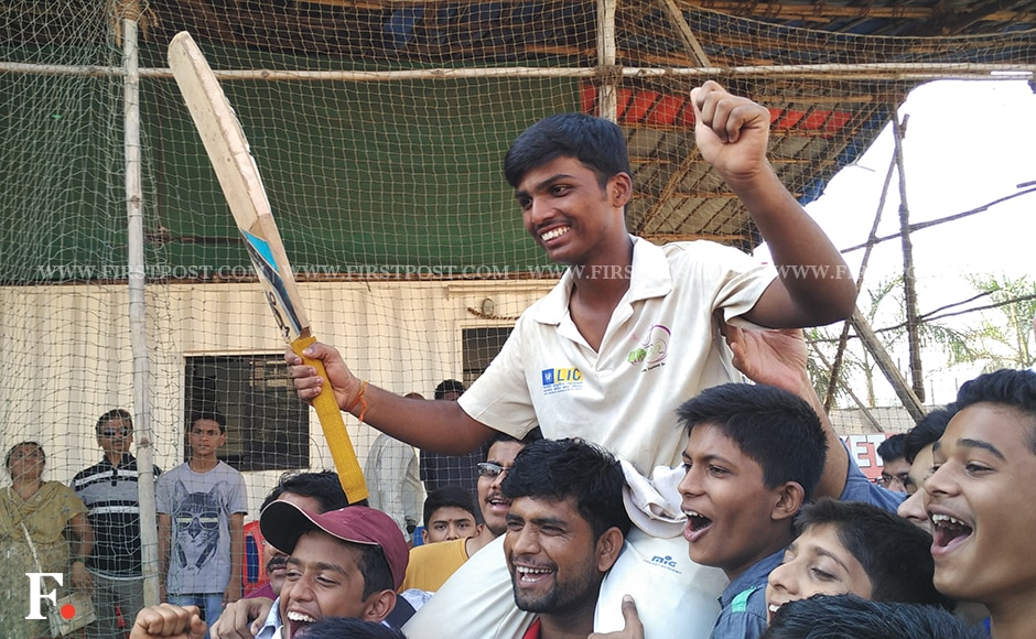 Pranav Dhanawade perched upon his friends after hitting record 1,009 runs not-out. Jigar Mehta/Firstpost