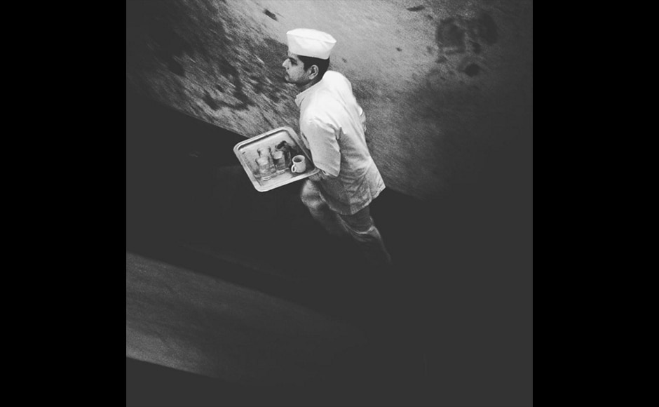 A waiter dressed in a classic white uniform, rushes up the stairs of Kolkata's The College Street Coffee house in this photograph by 31-year-old Anindito Mukherjee, a photojournalist with Reuters. With its Victorian charm and classic menu, the coffee house continues to be a popular hangout, for artists, intellectuals and the youth.