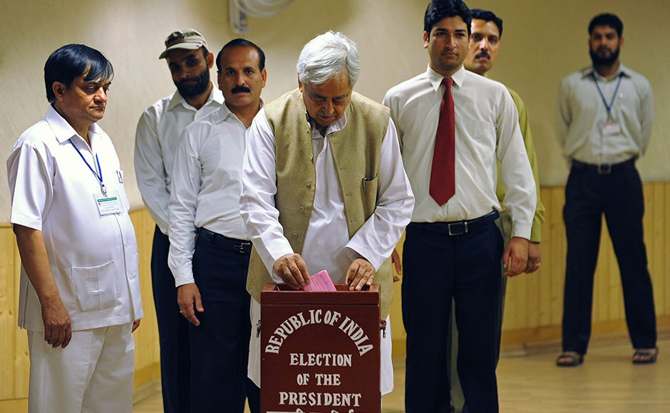 Jammu and Kashmir state People's Democratic Party (PDP) patron Mufti Mohammad Sayeed casts his vote for India's new president at the state assembly in Srinagar on July 19, 2012. Indian national and state lawmakers voted July 19 for a new president, with former finance minister Pranab Mukherjee seen as a certainty to take up the mainly ceremonial post. AFP