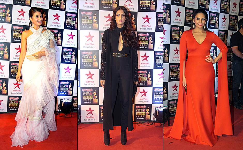 Jacqueline Fernandez, who will be seen in 'Housefull 3' next, opted for a traditional white sari with ruffles, whereas, Sonam Kapoor style statement was to go bold with black and gold jumpsuit and Huma Qureshi showed off her figure in a orange brick dress at the Screen Awards. Solaris Images.