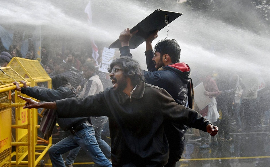 Police use water cannons to disperse students during a protest against the HRD Ministry in New Delhi. Rohith Vemula, a second year PhD student at University of Hyderabad, committed suicide on Sunday evening. This led to protests across the nation. PTI