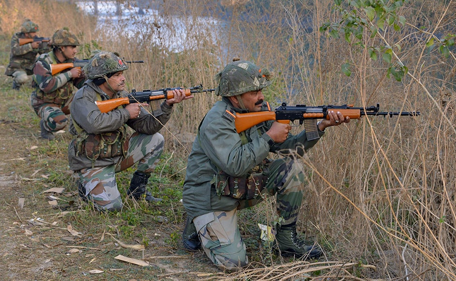 Soldiers are seen taking up position on the perimeter of the Air Force base in Pathankot which was attacked by terrorists. AFP