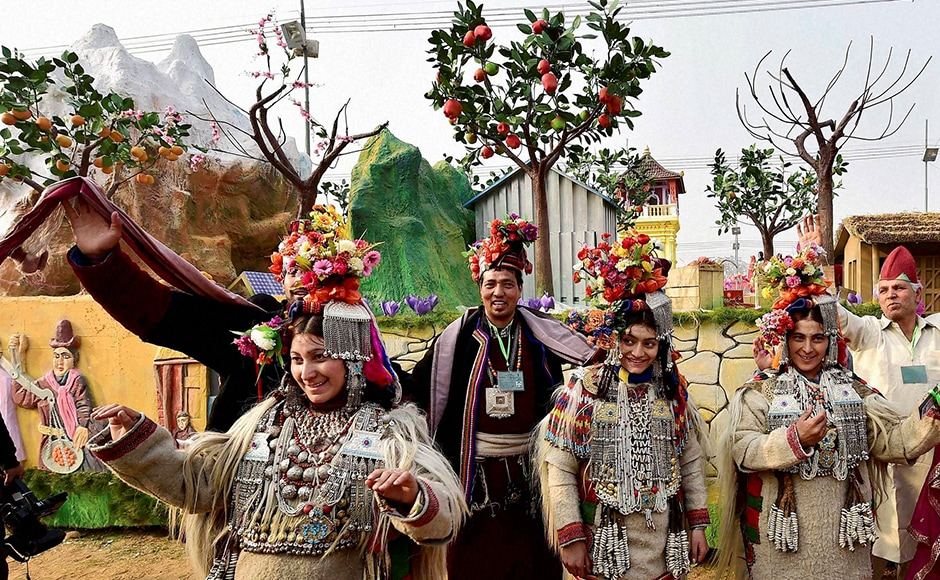 Jammu and Kashmir artists dance in front of their tableau for the Republic Day parade during a press preview in New Delhi on Friday. PTI