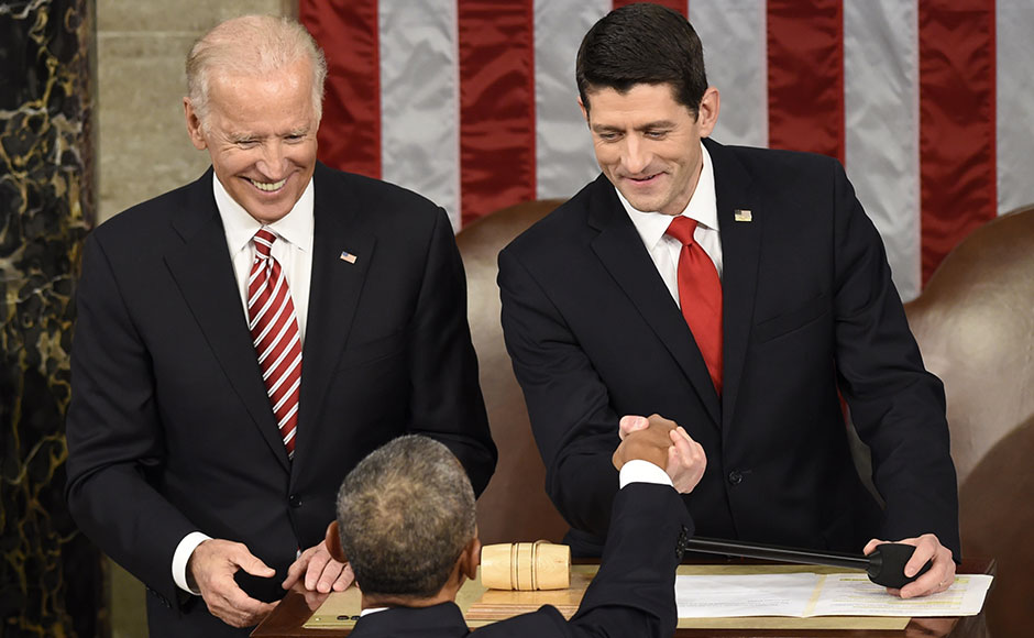 """House Speaker Paul Ryan and US Vice President Joe Biden shake hands with US President Barack Obama before the State of the Union Address. About 30 minutes into the address, Ryan's office released a statement that Obama's speech """"isn't going so well"""". AFP"""