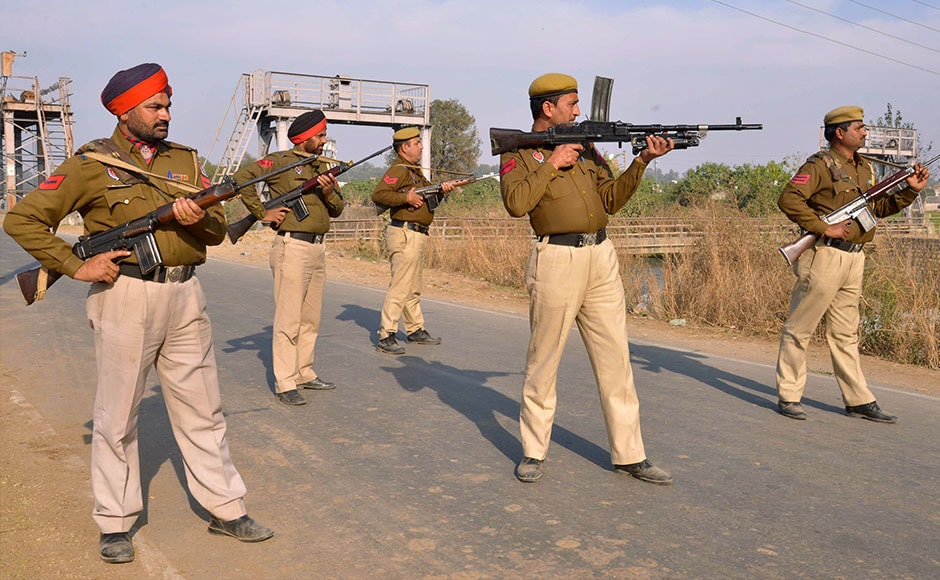 Police personnel stand alert outside the Air Force base on 2 January. The attack comes shortly after Prime Minister Narendra Modi's surprise visit to Pakistan. AFP