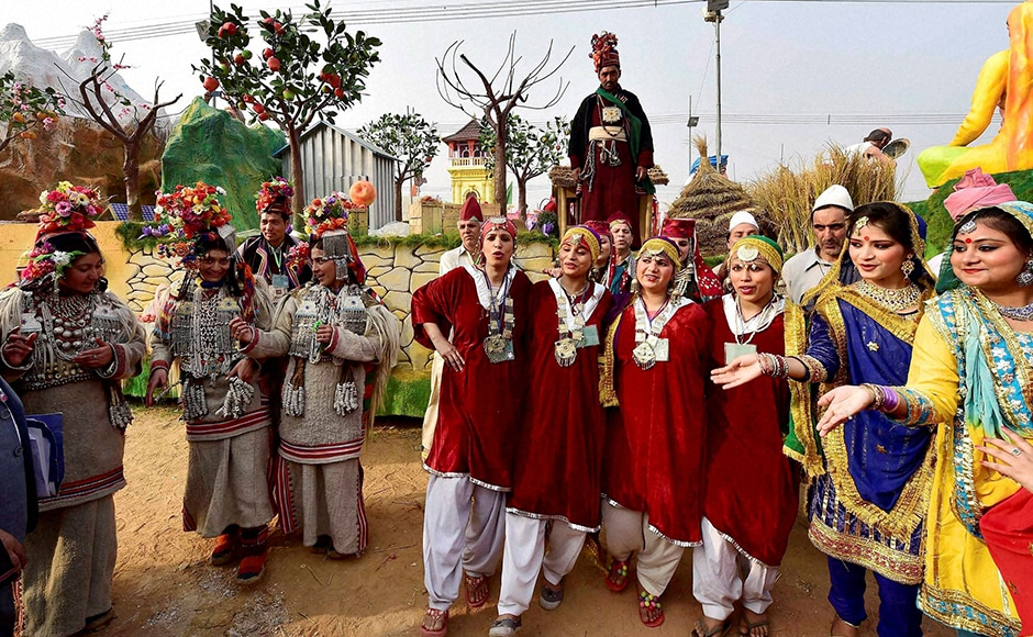 Jammu and Kashmir artists pose in front of their tableau for the Republic Day parade during a press preview in New Delhi on Friday. PTI