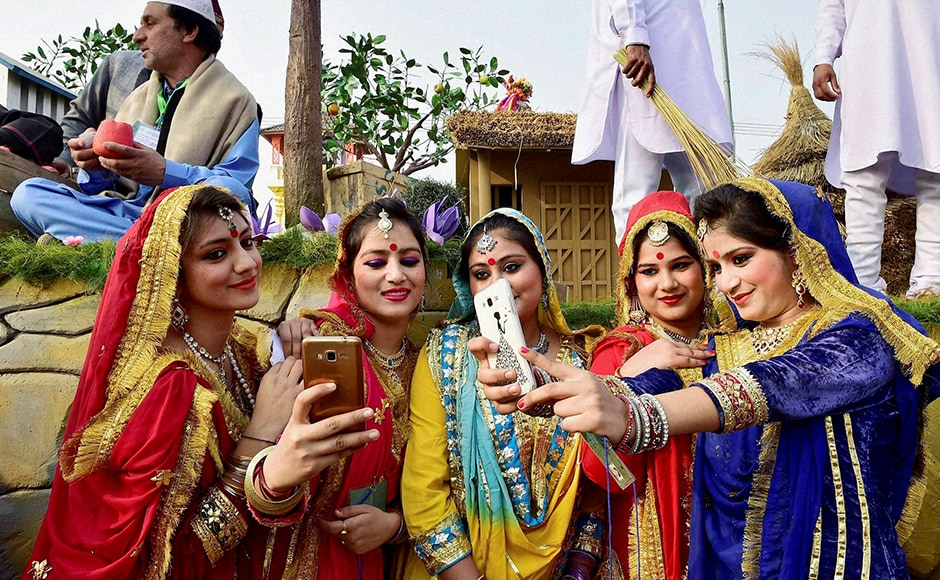 Selfie time for artists from Jammu and Kashmir as they click a selfie in front of their tableau for the Republic Day parade during a press preview in New Delhi on Friday. PTI