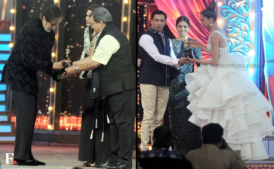 Amitabh Bachchan receives his award from Subhash Ghai while Deepika Padukone collects Priyanka Chopra's award on her behalf from Madhur Bhandarkar. Sachin Gokhale/Firstpost