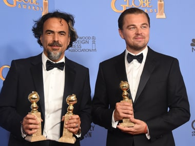 Alejandro González Iñárritu and Leonardo DiCaprio pose with their Golden Globes awards for The Revenant. AFP