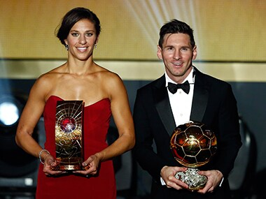 FC Barcelona's Lionel Messi of Argentina poses with Houston Dash's Carli Lloyd of the US with their World Player of the Year awards during the FIFA Ballon d'Or 2015 ceremony. Reuters