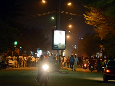 People gather on Kwame Nkruma avenue near Hotel Splendid where the attack took place. AFP