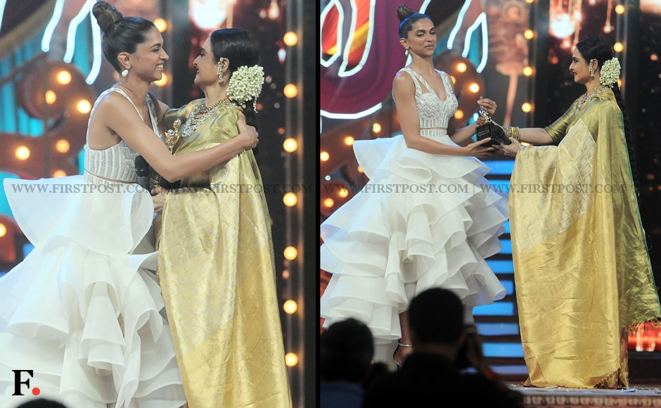 Deepika Padukone accepts her award - and a hug - from Rekha. Sachin Gokhale/Firstpost