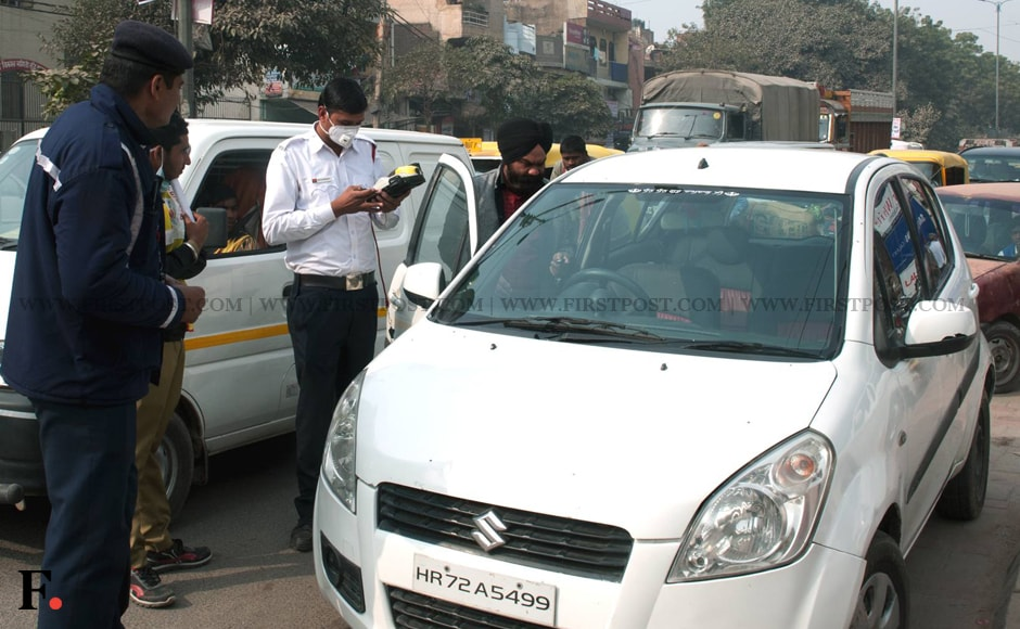 A challan is being issued to a car with a number plate ending with an odd digit. Image: Naresh Sharma/Firstpost.