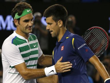 Novak Djokovic and  Roger Federer shake hands after Djokovic won their semi-final match. Reuters