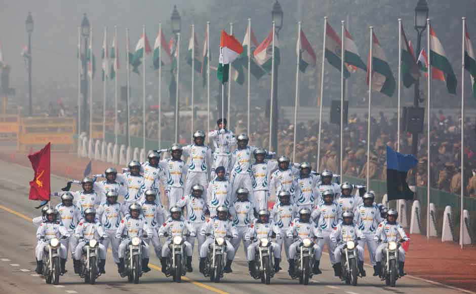 Indian Army soldiers of Signal Corps carry out a daredevil formation on motorcycles on Rajpath. Of the two-hour event at Rajpath, their various formations stole the show. The Corps of Signals has four world records to its credit and eight records in the Limca Book of Records. This particular Pyramid formation represents the unity and diversity of India. AP