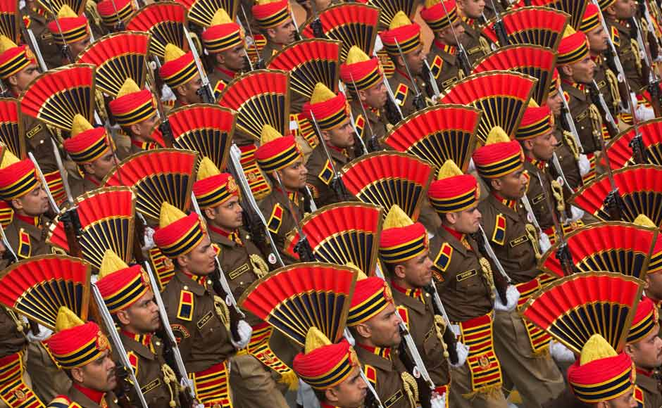 Indian security forces' colourful headgear make for a patriotic sight as they march during the parade. AP