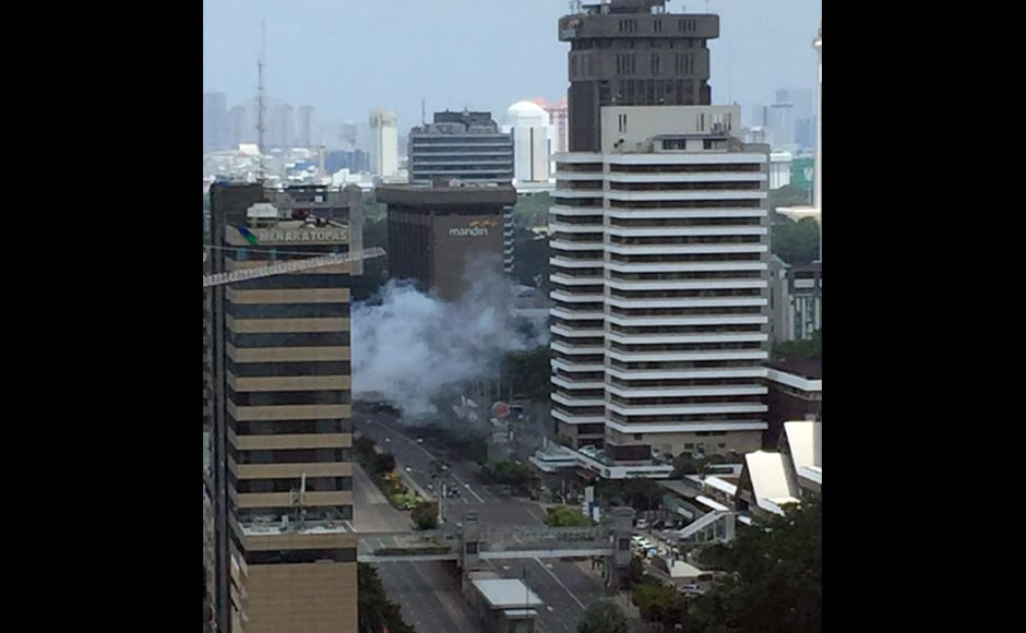 """Smoke billows from an explosion in Jakarta. At least four people have been reported dead in the terror attack. Indonesian President Joko """"Jokowi"""" Widodo, who is on a working visit in West Java town of Cirebon, has ordered security forces to hunt down the perpetrators. AP"""
